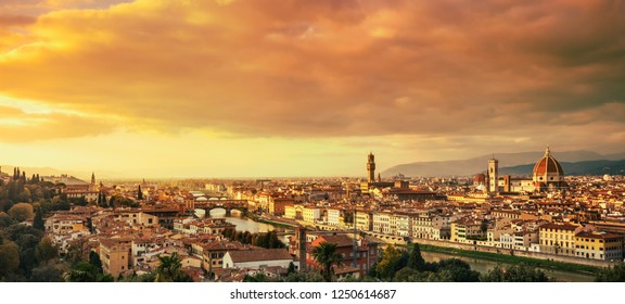 Florence or Firenze sunset aerial cityscape. Panorama view from Michelangelo park square. Ponte Vecchio bridge, Palazzo Vecchio and Duomo Cathedral. Tuscany, Italy