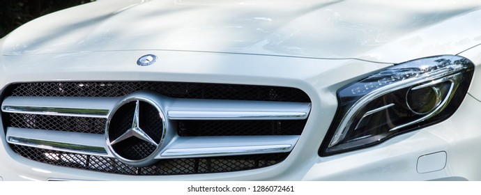 Florence, Italy - 01/14/2019: White Mercedes-Benz car detail. High detailed particular of a Mercedes Vehicle