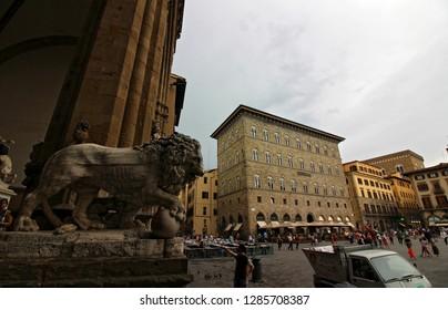 FLORENCE, ITALY - 05/30/2018: Loggia dei Lanzi, also called the Loggia della Signoria, is a building on a corner of the Piazza della Signoria in Florence, Italy, adjoining the Uffizi Gallery.