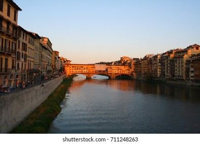 Florence, Italy - 07.18.2017: The Arno river with Ponte Vecchio bridge at sunset.