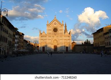 Florence, Italy - 07.18.2017: the main facade of Santa Croce basilica seen from Piazza di Santa Croce square at