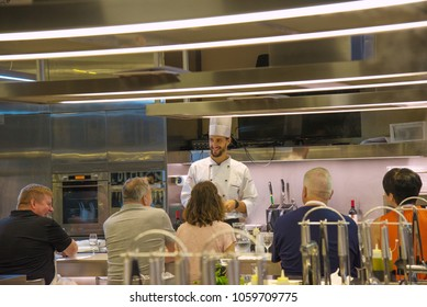 Florence, Italy - 09/16/2017: cooking class in Florence, at Mercato Centrale.  Cooking class listening to instructions on using ingredients of Tuscan cuisine