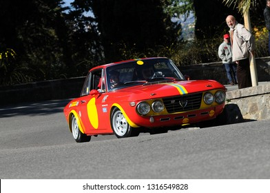 Florence, ITALY - 10 March 2012: Classic Historic Lancia Fulvia Coupé HF in action during public event of historical parade at Fiesole (Florence) in Italy.