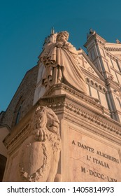 Florence, Italy 14 April 2019: Dante Alighieri Statue in front of Santa Croce Church in Florence
