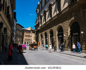 Florence, Italy - 17 April 2017 - People enjoying a beautiful day in Florence, Italy.