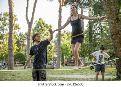 FLORENCE, ITALY - 21 JUNE 2015 - A tightrope teaches the technique for a girl walking on a slackline on June 21, 2015 in Florence (Italy)