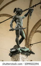Florence, Italy - 23 April, 2018: statues near Loggia dei Lanzi in Florence, Italy; Perseus with the Head of Medusa