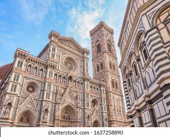 Florence, Italy. Ancient architecture. Colored marble facade of famous Cathedral or Cattedrale di Santa Maria del Fiore, Giotto's bell tower or Campanile near Baptistery of St.John in Piazza del Duomo