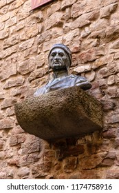 FLORENCE, ITALY - APRIL 08, 2018: Bust of the famous Italian poet Dante Alighieri on the wall of his house-museum