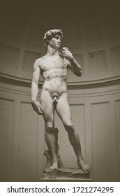 Florence, Italy - April 1, 2018: Famous white marble statue of David created by the Italian artist Michelangelo Buonarroti. One of major tourist attractions in the city. Vertical photo.