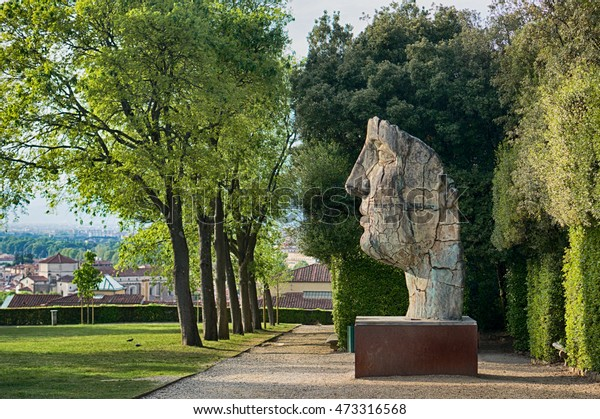 Florence, Italy - April 20, 2016. Gigantic human face - the sculpture of modern art in Boboli Gardens, Florence, Italy