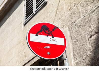 FLORENCE, ITALY - APRIL, 2018: Florence street sign art by Clet Abraham