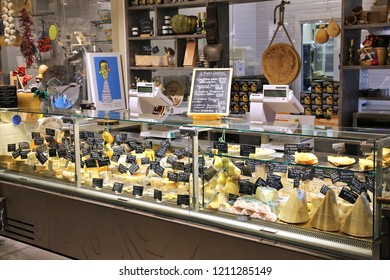 FLORENCE, ITALY - APRIL 29, 2015: Cheese store at Mercato Centrale market in Florence, Italy. The market is an ultimate Italian shopping experience. It was opened in 1874.
