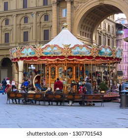 FLORENCE, ITALY - APRIL 30, 2015: People visit Piazza della Repubblica in Florence, Italy. Italy is visited by 47.7 million tourists a year (2013).