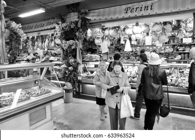 FLORENCE, ITALY - APRIL 30, 2015: People shop at Mercato Centrale market in Florence, Italy. The market is an ultimate Italian shopping experience. It was opened in 1874.