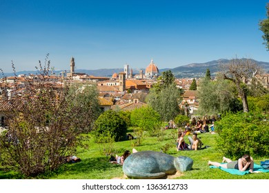 Florence, Italy - April 7, 2018: People relaxing in roses garden