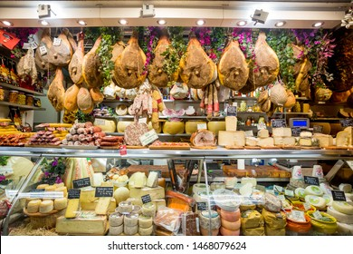 Florence, Italy - April 7, 2018: Farmers shop display of cheese and meat in San Lorenzo market