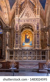 Florence, Italy - August 13, 2019: Interior of the Church of Orsanmichele, with the Andrea Orcagna's bejeweled Gothic Tabernacle, Florence, Italy.
