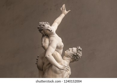 FLORENCE, ITALY - AUGUST 20, 2014: Ancient style sculpture of The Rape of the Sabine Women in Loggia dei Lanzi in Florence, Italy