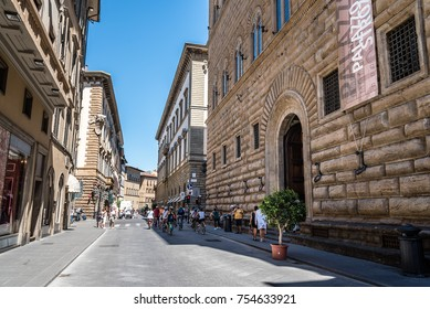 Florence, Italy - August 23, 2016: Palazzo Strozzi in Florence a sunny day of summer. It is a renaissance palace and an example of civil architecture with its rusticated stone.