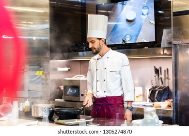 Florence, Italy - August 30, 2018: Kitchen restaurant in Firenze Centrale Mercato central market with cook chef teaching preparing food cooking class