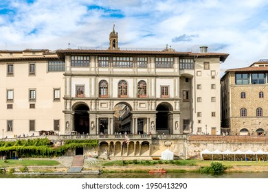 Florence, Italy - August 30, 2020: The Loggiato of the Uffizi Gallery, a semi-enclosed courtyard with niches and statues facing the river Arno, seen from via de' Bardi, Florence, Tuscany, Italy