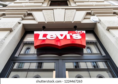 Florence, Italy - August 31, 2018: Low angle looking up view on Levi's, Levis storefront, building facade of shop, store in Firenze, Italian city with sign, logo, ancient architecture