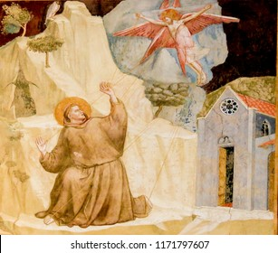 Florence, Italy - August 9, 2018: Famous Painting by Giotto of Saint Francis Receiving the Stigmata in the Bardi Chapel, Santa Croce Basilica, Florence, Italy