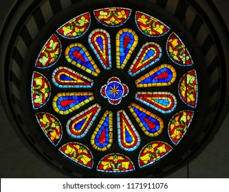 Florence, Italy - August 9, 2018: Stained Glass Round Window at the Basilica Santa Croce, Florence, Italy.