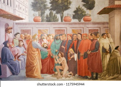 Florence, Italy - August 9, 2018: Raising of the Son of Theophilus, by Masaccio, famous Early Renaissance Fresco in the Brancacci Chapel in Florence, Italy