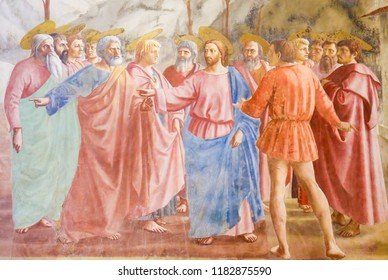 Florence, Italy - August 9, 2018: The Tribute Money, famous fresco by Masaccio in the Brancacci Chapel