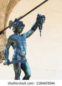 Florence, Italy - August 9, 2018: Perseus with the Head of Medusa is a bronze sculpture made by Benvenuto Cellini (16th Century), under Loggia dei Lanzi, Florence, Italy