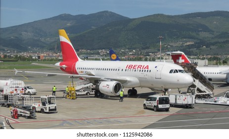 FLORENCE, ITALY - CIRCA APRIL 2016: Airbus A 319 aircraft of the Iberia airlines parked at the airport ready for boarding