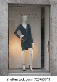FLORENCE, ITALY - CIRCA FEBRUARY 2012: stylish fashion shop in the city centre displaying high couture clothes, for which Italy is famous worldwide