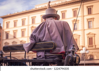 FLORENCE, ITALY - CIRCA FEBRUARY 2017: Nineteenth century style coachman on board his coach in Republic Square, Florence