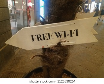 FLORENCE, ITALY - CIRCA JULY 2016: free wi-fi sign leading to a cafe that offers the wi-fi
