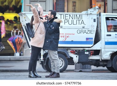FLORENCE  - ITALY, DEC24, 2016:  Young happy couple in love enjoying time together on street.True lovely emotions, brightful feelings, happiness, christmas time, in Florence, Italy