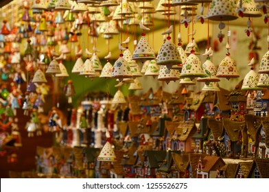 Florence, ITALY - DECEMBER 2018: small decorated bells hanging from the roof at the Christmas market in front of the 'Basilica of Santa Croce'. Christmas atmosphere, Italy.