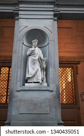 Florence, Italy - February 27, 2019 : View of Dante Alighieri statue at the Uffizi Gallery courtyard