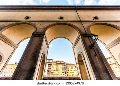 Florence, Italy Firenze orange yellow colorful buildings on street called Lungarno degli Acciaiuoli during summer in Tuscany with wide angle view of Corridoio Vasariano