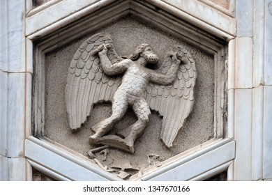 FLORENCE, ITALY - JANUARY 09, 2019: Daedalus as personification of mechanical arts from the workshop of Andrea Pisano, Relief on Giotto Campanile of Cattedrale di Santa Maria del Fiore, Florence