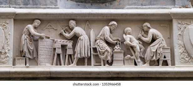FLORENCE, ITALY - JANUARY 09, 2019: Detail of the sculptors and architects at work, bas-relief (tabernacle of the Four Crowned Saints) by Nanni di Banco, in Orsanmichele Church in Florence, Italy