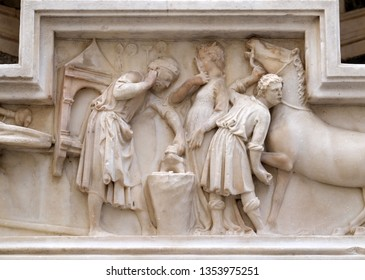 FLORENCE, ITALY - JANUARY 09, 2019: The miracle of Saint Eligius. Tabernacle bas-relief of a horseshoer made by Nanni di Banco and part of an external wall of Orsanmichele Church in Florence, Italy