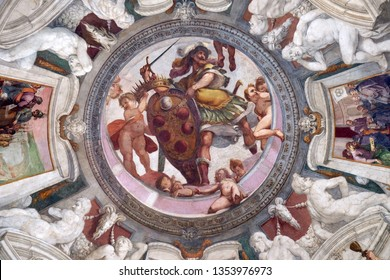 FLORENCE, ITALY - JANUARY 09, 2019: Mars holds the Medici coat of arms between putti fresco by Bernardino Poccetti Ospedale degli Innocenti - Exterior arcade, Florence, Italy