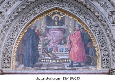 FLORENCE, ITALY - JANUARY 09, 2019: Charity among the founders of Florentine philanthropic institutions, Left Portal of Cattedrale di Santa Maria del Fiore, Florence, Italy