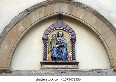 FLORENCE, ITALY - JANUARY 09, 2019: Madonna and Child by Giovanni Della Robbia on the portal of San Barnaba Church in Florence, Italy