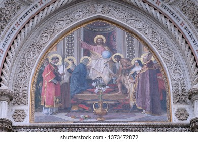 FLORENCE, ITALY - JANUARY 09, 2019: Christ Enthroned with Mary and St. John the Baptist Main Portal of Cattedrale di Santa Maria del Fiore (Cathedral of Saint Mary of the Flower), Florence, Italy