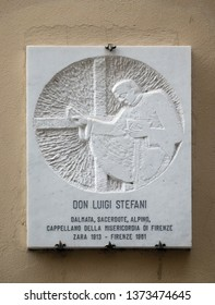 FLORENCE, ITALY - JANUARY 09, 2019: Marble plaque with a relief portrait of Don Luigi Stefani in Florence, Italy