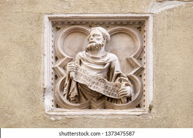 FLORENCE, ITALY - JANUARY 09, 2019: Biblical story, tile relief, external wall of Orsanmichele Church in Florence, Tuscany, Italy
