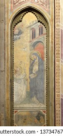 FLORENCE, ITALY - JANUARY 09, 2019: Annunciation to the Virgin Mary, fresco in Orsanmichele Church in Florence, Tuscany, Italy